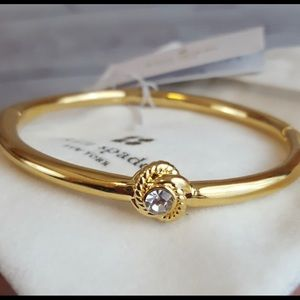 Kate Spade infinity knot hinged bangle gold tone